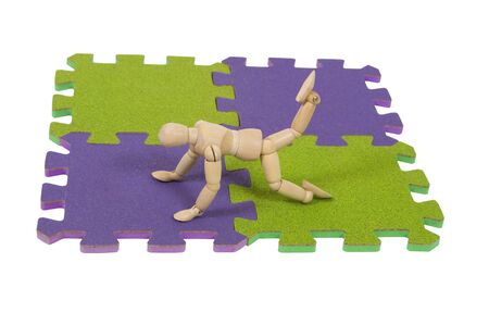 padding: Stretching for gymnatics and tumbling on a mat is a graceful array of movement - path included Stock Photo