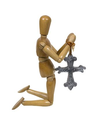 Model kneeling and praying with a large antique silver cross - path included photo