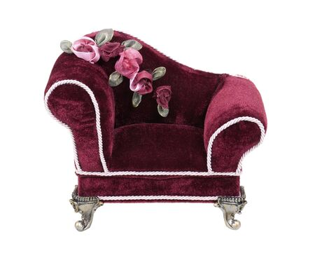 Red velvet lounge chaise with silver feet for leisurely rests - path included