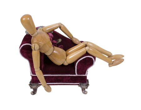 Laying about in a red velvet lounge chaise with silver feet for leisurely rests Stock Photo