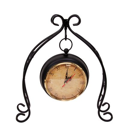 Formal clock hanging from a scrolled metal work to measure time passing Banco de Imagens