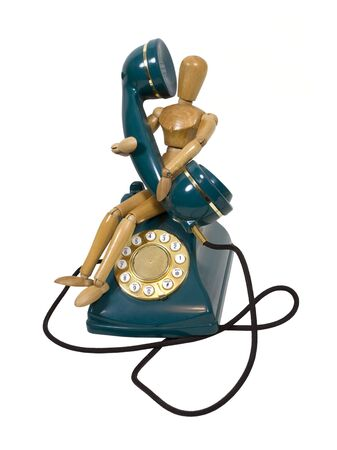 sturdy: Traditional desk phone with rotary dial held by a model taking a call
