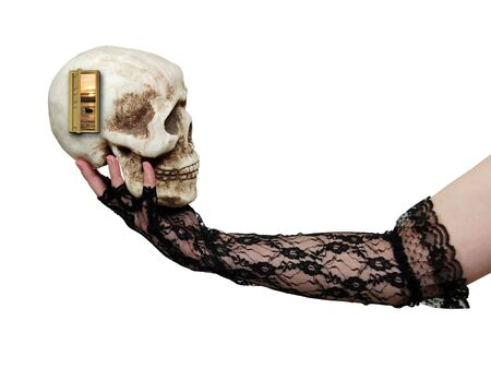 theatrics: Wearing lace gloves with a delicate pattern holding a skull with a doorway to serenity