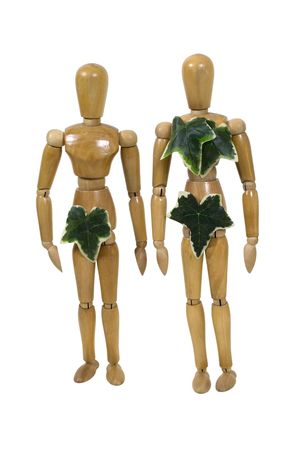 Wooden models wearing leaves as clothes to represent Adam and Eve