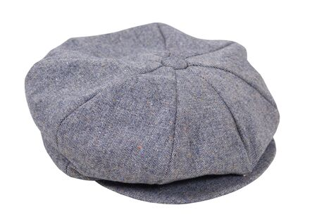 tweed: Masculine tweed flat driving cap worn on the head when out for a drive - path included Stock Photo