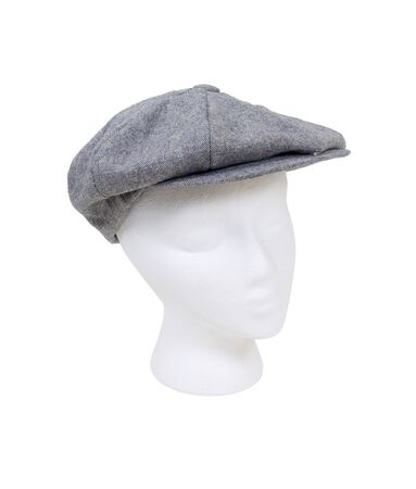 Wearing a masculine tweed flat driving cap worn on the head when out for a drive