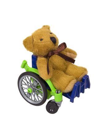 aide � la personne: Youth wheelchair shown by a teddy bear in a wheelchair used for assistance in personal transportation when ambulatory methods are unavailable