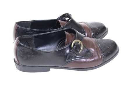 Black and tan leather saddle shoes with metal buckle
