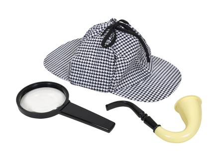Retro detective tools including a meershaum pipe, magnifying glass and a deerstalker hat  Stock Photo