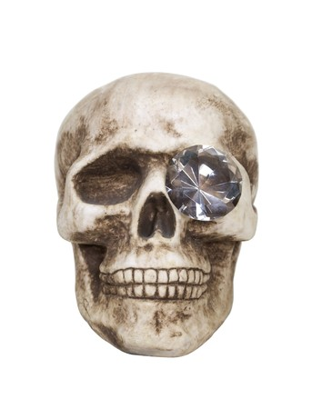 eye socket: Sharp vision shown by a skull with a diamond in his eye socket  Stock Photo