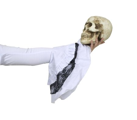 Wearing a white gothic lace outfit and holding a skull with eye sockets and teeth