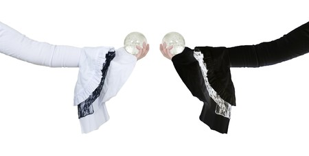 foresee: White and black gothic lace outfits holding out crystal balls  Stock Photo