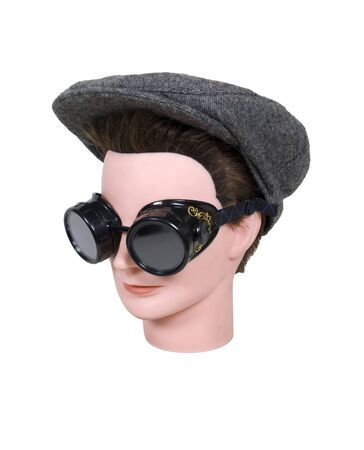 leisurely: Ready for a leisurely drive wearing black steam punk goggles and a tweed driving cap