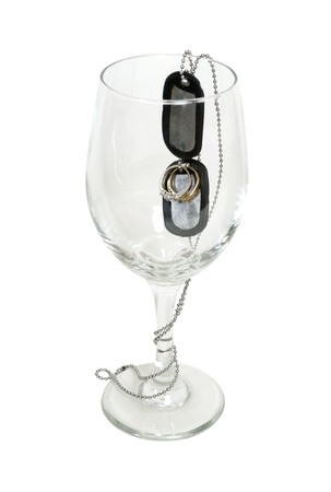 glasswear: Celebrate my soldier is home shown by military dog tags with wedding rings in a wine glass