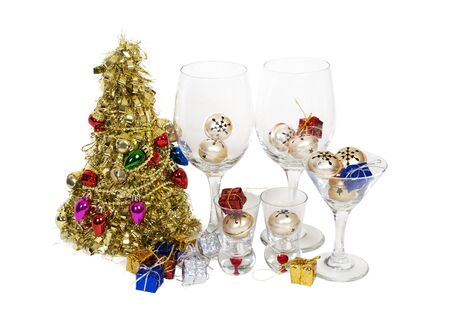 glasswear: Holiday cheers with a brightly decorated golden Christmas tree and a variety of glasses for celebrating the winter season