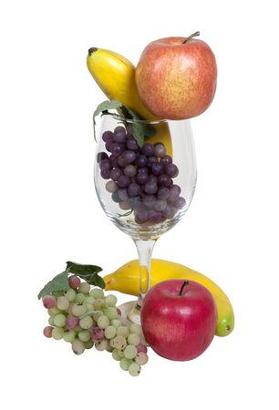 glasswear: Fuit cocktail shown by fruit in and surrounding a large wine glass