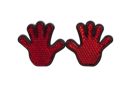 reflect: Red reflective hands designed to reflect light back as a safety measure in the dark