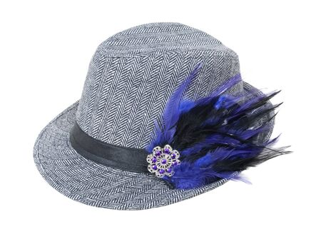 Houndstooth tweed hat with elegant gem and feather element for a sophisticated look