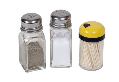 toothpick: Salt and pepper shakers and a toothpick dispenser