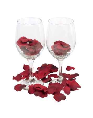 glasswear: Wine glass with a gentle flute filled with red rose pedals  Stock Photo