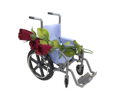 soft pedal: Road to Recovery shown by red roses laid across a wheelchair used for assistance in personal transportation