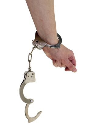 breaking out: Breaking out of handcuffs made of metal with mechanical clasp