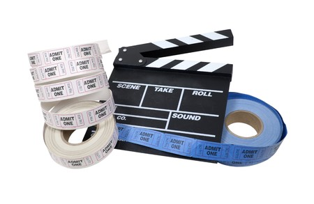 Movie time shown by roll of admission tickets and a movie marker board Reklamní fotografie