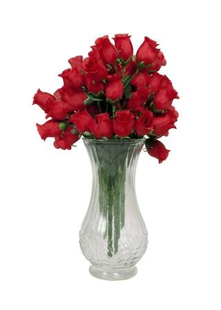 A dozen long-stem red roses in a crystal vase