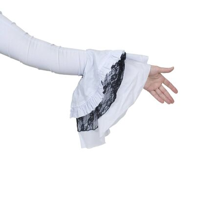 Extending a handshake wearing a delicate and feminine gothic white lace outfit