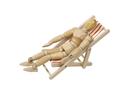 lounging: Lounging in a folding beach chair with stripes for relaxing while on vacation - path included