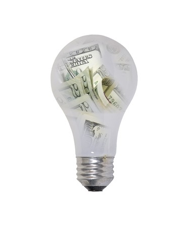 Money ideas shown by a round glass lightbulb filled with money - path included