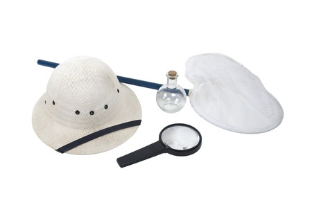 pith: Specimen collection kit shown by a pith helmet, butterfly net, magnifying glass, and sample jar