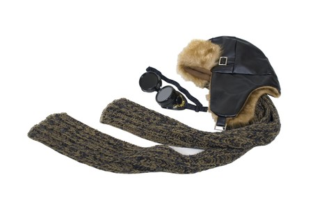Steampunk aviator kit including goggles worn to protect the eyes, and an aviator hat and scarf  Stock Photo