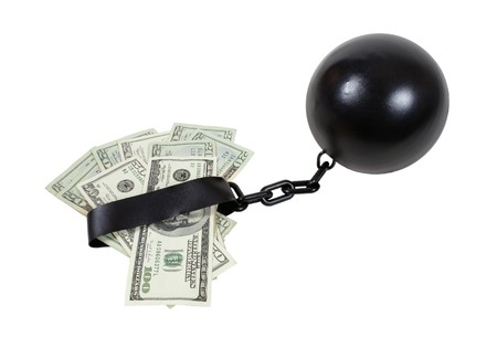 ball and chain: Money bound by interest shown by money attached to a ball and chain - Stock Photo