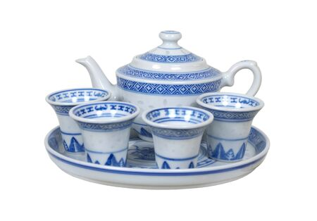 repast: Formal tea cups and teapot with a delicate blue china pattern for drinking tea - Stock Photo
