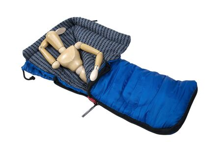 Model lying in a sleeping bag used to keep warm on camping trips and staring up into the sky -