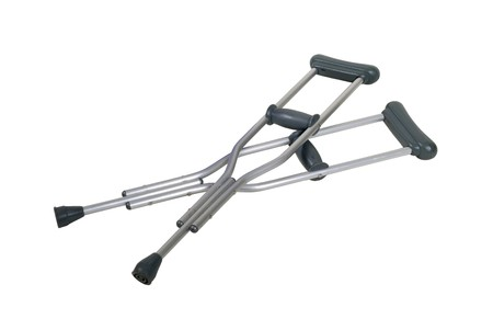 Metal adjustable crutches to assist when walking short distances - Path included Stock Photo