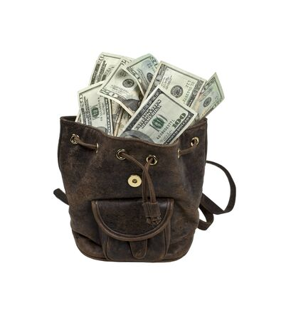 amounts: Rustic brown backpack full of large amounts of cash