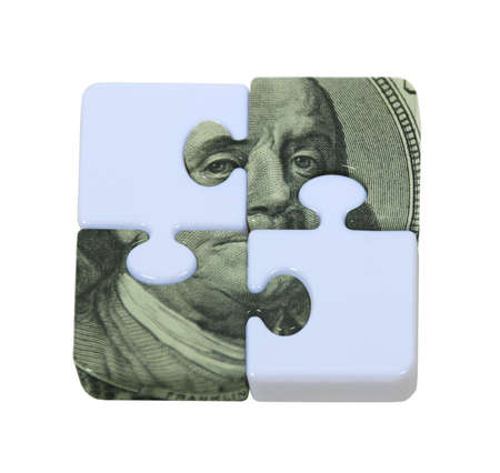 The puzzle of money shown by contrasting puzzle pieces interlocked with money portions