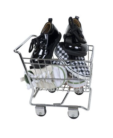 Shoe shopping shown by a variety of shoes in a shopping cart Stock Photo - 8102358