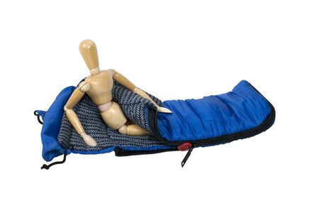 padding: Model sitting up in a sleeping bag used to keep warm on camping trips