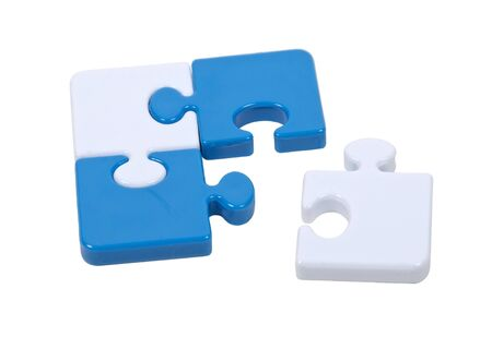 A piece of the puzzle pulled out of a contrasting color puzzle interlocked together to make a pleasing pattern 版權商用圖片