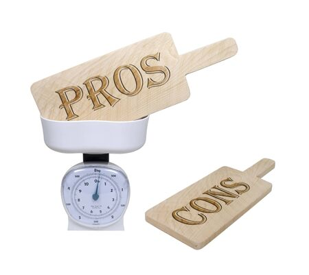 Weighing pros and cons shown by pro and con wooden signs in a basket scale