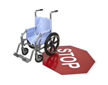 Wheelchair used for assistance in personal transportation on a red stop sign Reklamní fotografie - 8186634