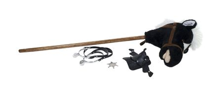 Child cowboy kit including spurs, sheriff star, saddle and a hobby horse