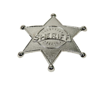 Silver five pointed star sherff badge with raised lettering photo