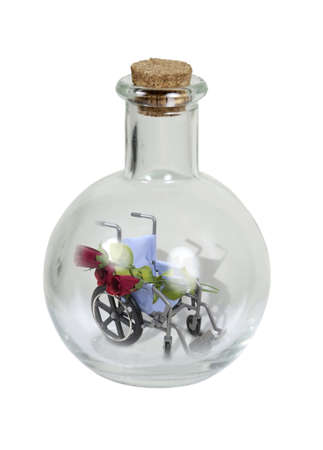 Elixir of health shown by a wheelchair with roses in a round glass bottle with cork stopper