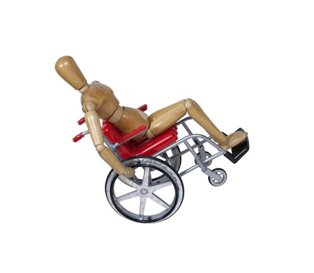 unavailable: Popping a wheelie in a wheelchair used for assistance in personal transportation when ambulatory methods are unavailable - path included Stock Photo
