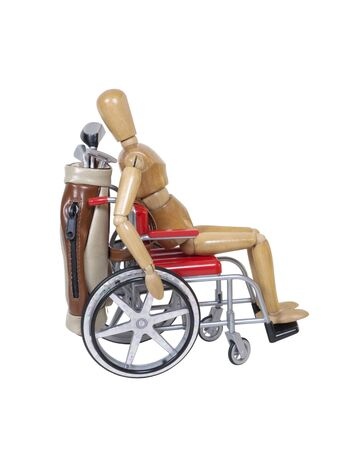 Riding in a wheelchair with a set of golf clubs in a golf bag