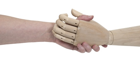 grasp: Impersonal agreements shown by an agreement handshake with a wooden figure that is not human - path included